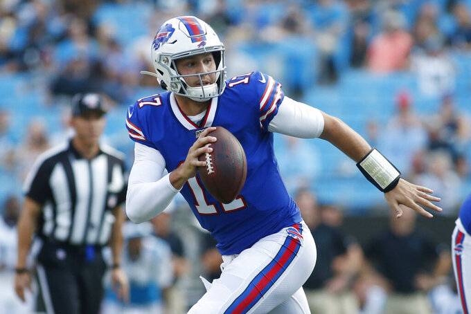 FILE - In this Aug. 16, 2019, file photo, Buffalo Bills quarterback Josh Allen (17) runs out of the pocket against the Carolina Panthers during the first half an NFL preseason football game, in Charlotte, N.C. Given the many variables that go into developing an elite quarterback, Pro Football Hall of Famer Jim Kelly can't even imagine assessing what to make of last year's group of five first-round draft picks as they enter their sophomore seasons.  (AP Photo/Brian Blanco, File)