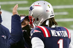 New England Patriots offensive coordinator Josh McDaniels, left, celebrates a touchdown catch by quarterback Cam Newton, right, in the second half of an NFL football game against the New York Jets, Sunday, Jan. 3, 2021, in Foxborough, Mass. (AP Photo/Elise Amendola)
