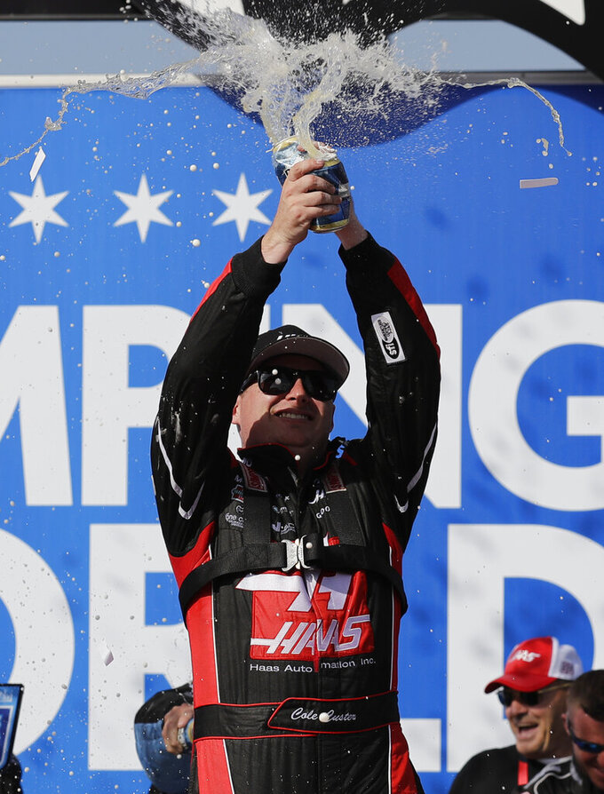 Cole Custer celebrates with his crew in Victory Lane after winning the NASCAR Xfinity Series auto race at Chicagoland Speedway in Joliet, Ill., Saturday, June 29, 2018. (AP Photo/Nam Y. Huh)