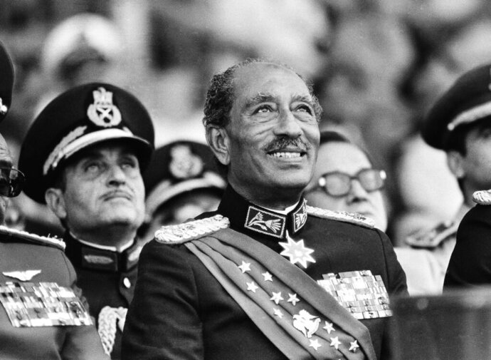 FILE - In this Oct. 6, 1981 file photo, Egyptian President Anwar Sadat smiles at the start of the military parade in Cairo. Later, during the parade, Sadat was killed with eleven others when gunmen opened fire on the reviewing stand with automation weapons.   (AP Photo/Bill Foley, File)