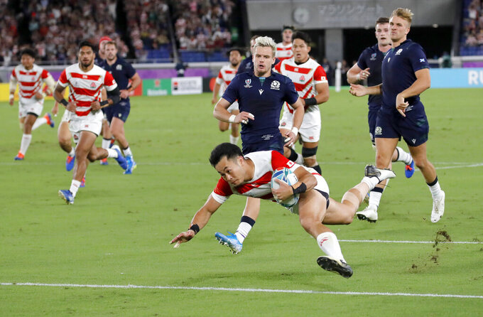 FIEL - In this Oct. 13, 2019, file photo, Japan's Kenki Fukuoka crosses the goal line for his team's third try against Scotland during the Rugby World Cup Pool A match at the International Stadium in Yokohama, Japan. (AP Photo/Christophe Ena, File)