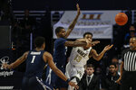 Wake Forest guard Andrien White, right, battles with Xavier forward Naji Marshall for the ball as Xavier guard Paul Scruggs (1) looks on in the second half of an NCAA college basketball game in Winston-Salem, N.C., Saturday, Dec. 14, 2019.  (AP Photo/Nell Redmond)
