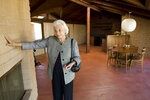 FILE - In this March 1, 2010, retired Supreme Court Justice Sandra Day O'Connor shows her 1958 adobe home that was moved and restored at the Arizona Historical Society Museum in Tempe, Ariz. O'Connor's 1950s adobe home in metro Phoenix is being listed on the National Register of Historic Places. The State Historic Preservation Office's announcement Friday, July 19, 2019,  says the National Park Service approved Arizona's nomination of the Sandra Day O'Connor House for placement on the register, which the office described as the nation's list of properties considered worthy of preservation. (David Wallace/The Arizona Republic via AP)