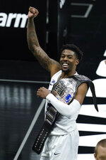 Penn State's Jamari Wheeler celebrates he leaves the court following the team's NCAA college basketball game against Nebraska at the Big Ten men's tournament Wednesday, March 10, 2021, in Indianapolis. (AP Photo/Darron Cummings)