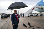 President Donald Trump speaks to reporters at Andrews Air Force Base, Md., as as he returns from campaign stops in Florida and Georgia Friday, Sept. 25, 2020. (AP Photo/Evan Vucci)