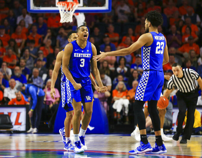 Kentucky guard Keldon Johnson celebrates with forward EJ Montgomery after Florida called a timeout during the second half of an NCAA college basketball game Saturday, Feb. 2, 2019, in Gainesville, Fla. Kentucky defeated Florida 65-54. (AP Photo/Matt Stamey)
