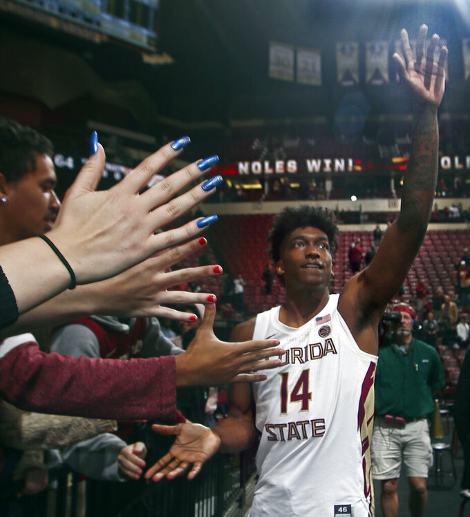 Florida State guard Terance Mann (14) shakes hands with fans after an NCAA college basketball game in Tallahassee, Fla., Tuesday, March 5, 2019. Florida State won 73-64 in overtime. (AP Photo/Phil Sears)