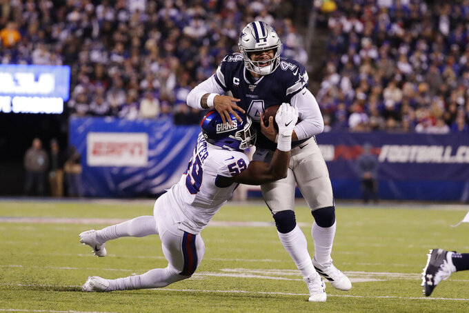 Dallas Cowboys quarterback Dak Prescott (4) is sacked by New York Giants linebacker Lorenzo Carter (59) during the third quarter of an NFL football game, Monday, Nov. 4, 2019, in East Rutherford, N.J. (AP Photo/Adam Hunger)