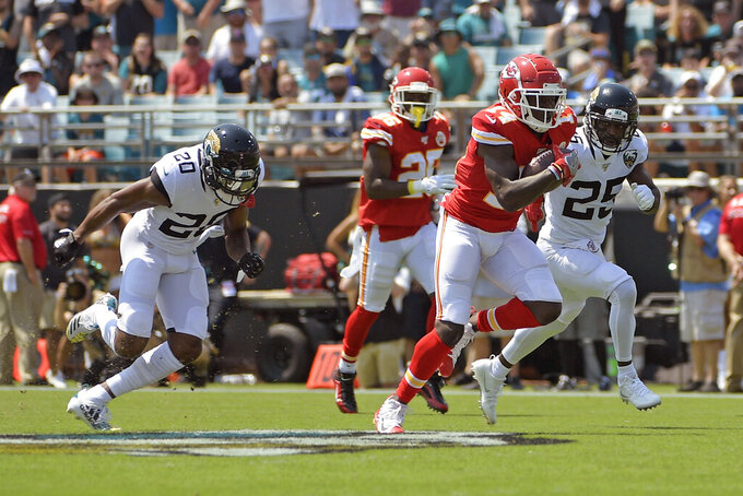 Kansas City Chiefs wide receiver Sammy Watkins, front right, runs past Jacksonville Jaguars defensive back D.J. Hayden (25) and cornerback Jalen Ramsey (20) on his way to a 68-yard touchdown on a pass play during the first half of an NFL football game, Sunday, Sept. 8, 2019, in Jacksonville, Fla. (AP Photo/Phelan M. Ebenhack)
