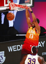 Utah Jazz center Tony Bradley (13) dunks as Los Angeles Lakers center Dwight Howard (39) watches during the first half of an NBA basketball game Monday, Aug. 3, 2020, in Lake Buena Vista, Fla. (Kim Klement/Pool Photo via AP)