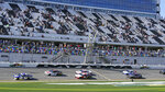 Chase Elliott (9), Michael McDowell (34), Austin Dillon (3), and Denny Hamlin (11) lead the field to start the NASCAR Cup Series road-course auto race at Daytona International Speedway, Sunday, Feb. 21, 2021, in Daytona Beach, Fla. (AP Photo/John Raoux)