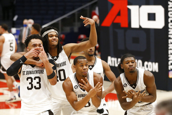 St. Bonaventure players celebrate after beating VCU in an NCAA college basketball championship game for the Atlantic Ten Conference tournament Sunday, March 14, 2021, in Dayton, Ohio. St.  (AP Photo/Jay LaPrete)