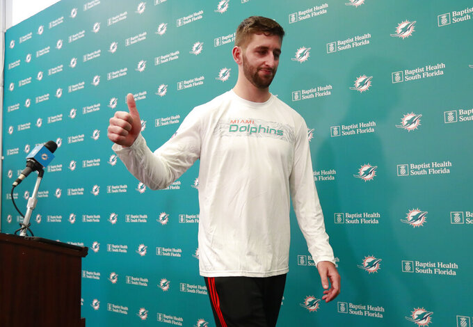 Miami Dolphins NFL football quarterback Josh Rosen gives a thumbs up as he leaves after speaking at a news conference, Monday, April 29, 2019, at the Dolphins training facility in Davie, Fla. The Dolphins traded a 2019 second-round draft pick and a 2020 fifth-round selection to Arizona for Rosen. (AP Photo/Wilfredo Lee)