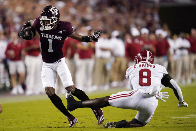 Texas A&M wide receiver Demond Demas (1) gets away from Alabama linebacker Christian Harris (8) during the first quarter of an NCAA college football game Saturday, Oct. 9, 2021, in College Station, Texas. (AP Photo/Sam Craft)