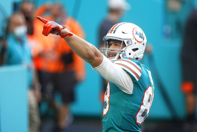 Miami Dolphins tight end Mike Gesicki (88) gestures after scoring a touchdown, during the first half of an NFL football game against the Kansas City Chiefs, Sunday, Dec. 13, 2020, in Miami Gardens, Fla. (AP Photo/Wilfredo Lee)
