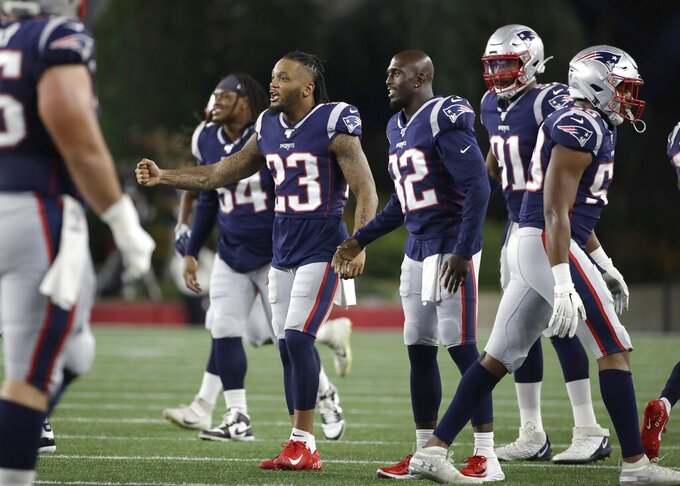 New England Patriots' Patrick Chung (23) Devin McCourty (32), and Deatrich Wise (91), encourage teammates after a series of plays in the first half of an NFL preseason football game against the New York Giants, Thursday, Aug. 29, 2019, in Foxborough, Mass. (AP Photo/Elise Amendola)