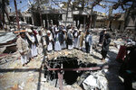 FILE- In this Oct. 13, 2016 file photo, members of the Higher Council for Civilian Community Organization inspect a destroyed funeral hall as they protest against a deadly Saudi-led airstrike on a funeral hall six days ago, in Sanaa, Yemen. A database project that tracks violence says Yemen's civil war has left more than 100,000 people dead since 2015. The Armed Conflict Location & Event Data Project, or ACLED, said Thursday, Oct. 31, 2019, the war's death toll includes more than 12,000 civilians killed in attacks directly targeting civilians. (AP Photo/Hani Mohammed, File)