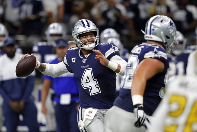Dallas Cowboys quarterback Dak Prescott (4) passes in the first half of an NFL football game against the New Orleans Saints in New Orleans, Sunday, Sept. 29, 2019. (AP Photo/Bill Feig)