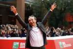 """FILE - In this Sunday, Oct. 23, 2016 filer, Roberto Benigni poses for photographers as he arrives on the red carpet at the Rome Film Festival. The Venice Film Festival said Thursday, April 15, 2021 it will give its lifetime achievement award this year to Oscar-winning director and actor Roberto Benigni. The Golden Lion for Lifetime Achievement is to be awarded at 78th edition of the world's oldest film festival, scheduled for Sept. 1-11 on the Lido. Benigni wrote, directed and starred in """"La Vita e Bella,"""" (""""Life is Beautiful""""), which won the Oscar for best foreign language film, best actor and best musical score in 1999. (AP Photo/Gregorio Borgia, File)"""