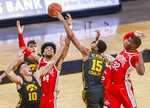 Iowa forward Keegan Murray (15) attempts a shot under pressure from Ohio State forwards Justice Sueing (14) and E.J. Liddell (32) during an NCAA college basketball game in Iowa City, Iowa, Thursday, Feb. 4, 2021. (Rebecca F. Miller/The Gazette via AP)