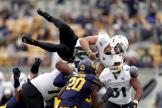 Sacramento State quarterback Asher O'Hara (10) leaps for a touchdown against California during the first half of an NCAA college football game on Saturday, Sept. 18, 2021, in Berkeley, Calif. (AP Photo/Jed Jacobsohn)