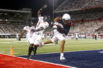 Arizona wide receiver Drew Dixon (1) attempts to catch a pass in the end zone as Texas Tech defensive back Adrian Frye (7) defends during the first half of an NCAA college football game, Saturday, Sept. 14, 2019, in Tucson, Ariz. (AP Photo/Ralph Freso)