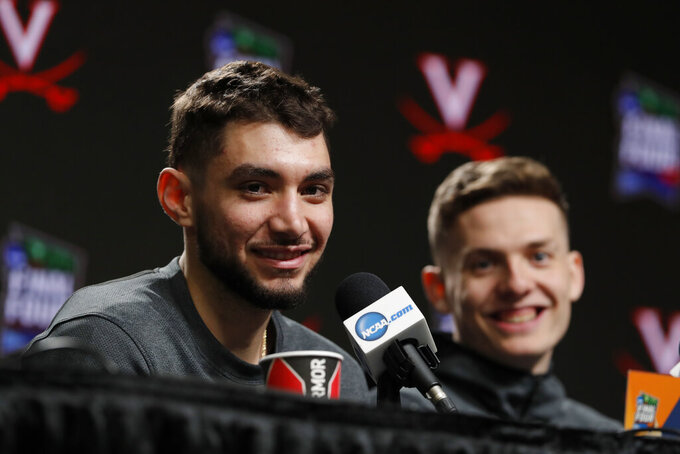 Virginia's Ty Jerome, left, and Kyle Guy answer questions during a news conference for the championship of the Final Four NCAA college basketball tournament, Sunday, April 7, 2019, in Minneapolis. Virginia will play Texas Tech on Monday for the national championship. (AP Photo/Charlie Neibergall)