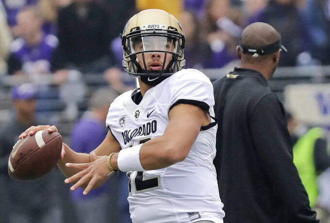 Colorado quarterback Steven Montez passes during warmups before an NCAA college football game against Washington, Saturday, Oct. 20, 2018, in Seattle. (AP Photo/Ted S. Warren)
