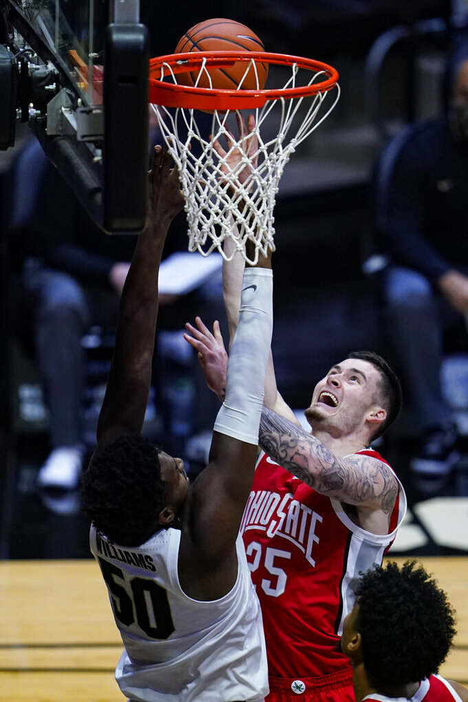 Ohio State forward Kyle Young (25) shoots over Purdue forward Trevion Williams (50) during the first half of an NCAA college basketball game in West Lafayette, Ind., Wednesday, Dec. 16, 2020. (AP Photo/Michael Conroy)