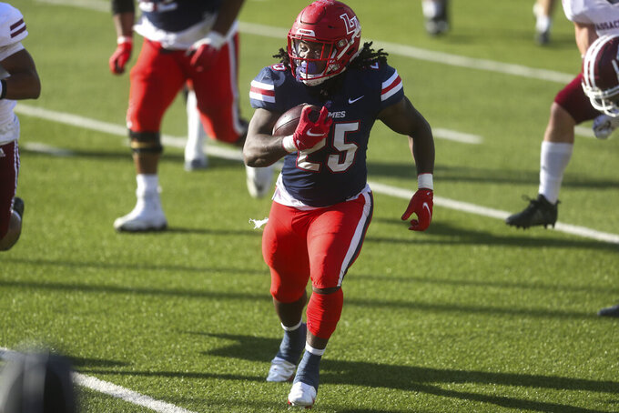 Liberty running back Peytton Pickett (25) caries the ball during the second half of a NCAA college football game against Massachusetts on Friday, Nov. 27, 2020, at Williams Stadium in Lynchburg, Va. (AP Photo/Shaban Athuman)