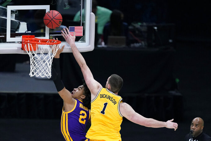 LSU forward Trendon Watford (2) drives to the basket ahead of Michigan center Hunter Dickinson (1) during the first half of a second-round game in the NCAA men's college basketball tournament at Lucas Oil Stadium Monday, March 22, 2021, in Indianapolis. (AP Photo/Darron Cummings)