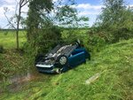A car lies upside down in a ditch following a suspected tornado, Saturday, April 13, 2019 in Franklin, Texas. (Laura McKenzie/College Station Eagle via AP)