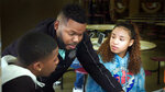 In this image released by HBO, Mayor Michael Tubbs, center, with students Isaiah Evans, left, and Joy Almendarez in Stockton, Calif., in a scene from the documentary