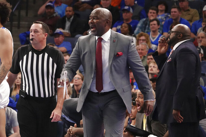 South Carolina State coach Murray Garvin shouts during the first half of the team's NCAA college basketball game against Memphis on Tuesday, Nov. 5, 2019, in Memphis, Tenn. (AP Photo/Karen Pulfer Focht)