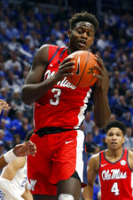 Mississippi's Khadim Sy pulls down a rebound in the first half of an NCAA college basketball game against Kentucky in Lexington, Ky., Saturday, Feb. 15, 2020. (AP Photo/James Crisp)