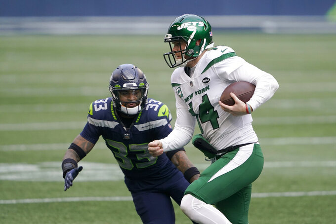 Seattle Seahawks strong safety Jamal Adams (33) pressures New York Jets quarterback Sam Darnold during the first half of an NFL football game, Sunday, Dec. 13, 2020, in Seattle. (AP Photo/Ted S. Warren)