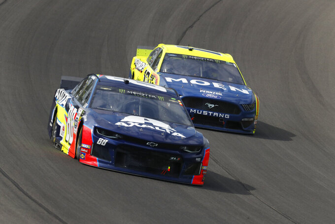 Alex Bowman (88) beats Ryan Blaney (12) into Turn 1 during a NASCAR Cup Series auto race at Michigan International Speedway in Brooklyn, Mich., Sunday, Aug. 11, 2019. (AP Photo/Paul Sancya)