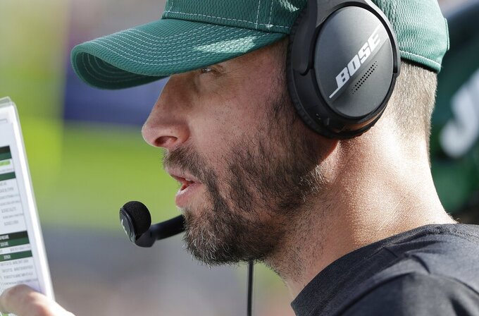 New York Jets head coach Adam Gase watches from the sideline in the second half of an NFL football game against the New England Patriots, Sunday, Sept. 22, 2019, in Foxborough, Mass. (AP Photo/Steven Senne)