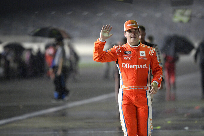 Harrison Burton leaves pit road during a rain delay in a NASCAR Xfinity Series auto race at Daytona International Speedway, Friday, Aug. 27, 2021, in Daytona Beach, Fla. (AP Photo/Phelan M. Ebenhack)