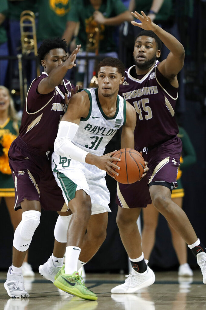 Baylor guard MaCio Teague (31) looks to make a pass as Texas State's Shelby Adams, left, and Eric Terry (45) defend during the first half of an NCAA college basketball game in Waco, Texas, Friday, Nov. 15, 2019. (AP Photo/Tony Gutierrez)