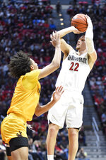 San Diego State guard Malachi Flynn (22) shoots over Wyoming guard Kwane Marble II (3) during the first half of an NCAA college basketball game Tuesday, Jan. 21, 2020, in San Diego. (AP Photo/Denis Poroy)