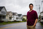 Rental property owner Ryan David poses for a photograph in Pittston, Pa., Wednesday, Aug. 18, 2021. Landlords say they have suffered financially due to various state, local and federal moratoriums in place since last year, amid the pandemic. David fears the $2,000 he's owed in back rent will quickly climb to thousands more as a result of the Centers for Disease Control and Prevention announcing a new moratorium, lasting until Oct. 3. (AP Photo/Matt Rourke)