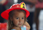 Kendall Hargrove, 5, wears a plastic firefighter helmet during the grand opening of Fire Station No. 1 in Galveston on Wednesday, Aug. 21, 2019. City officials, first responders and community members were all in attendance to celebrate the opening. Firefighters will be moving into their expanded, renovated space this week. (Kelsey Walling/The Galveston County Daily News via AP)