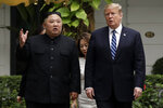 FILE - In this Feb. 28, 2019, file photo, U.S. President Donald Trump and North Korean leader Kim Jong Un take a walk after their first meeting at the Sofitel Legend Metropole Hanoi hotel, in Hanoi, Vietnam. South Korea's president Moon Jae-in on Tuesday, June 25, 2019, said North Korean and U.S. officials are holding