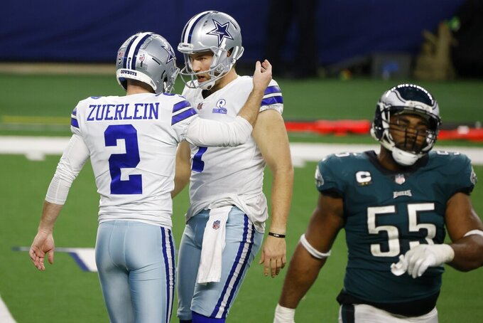Dallas Cowboys' Greg Zuerlein (2) and Hunter Niswander (1) celebrate Zuerlein's field goal kick as Philadelphia Eagles defensive end Brandon Graham (55) walks back to the sideline in the second half of an NFL football game in Arlington, Texas, Sunday, Dec. 27. 2020. (AP Photo/Michael Ainsworth)