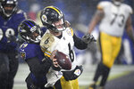 Pittsburgh Steelers quarterback Devlin Hodges (6) tries to throw a pass from his team's end zone as Baltimore Ravens cornerback Brandon Carr (39) grabs him during the second half of an NFL football game, Sunday, Dec. 29, 2019, in Baltimore. Hodges was penalized for an intentional grounding penalty and the Ravens were given two points on a the safety. The Ravens won 28-10. (AP Photo/Nick Wass)