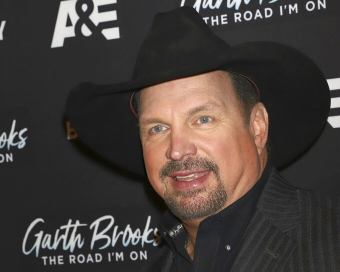 """FILE - In this Nov. 18, 2019 file photo, Garth Brooks attends cocktails and conversation in celebration of A&E Biography's """"Garth Brooks: The Road I'm On"""" television special at The Bowery Hotel in New York. This year's Kennedy Center Honors will be a slimmed-down affair as the nation emerges from the coronavirus pandemic. The 43rd class of honorees includes country music legend Garth Brooks, dancer and choreographer Debbie Allen, actor Dick Van Dyke, singer-songwriter Joan Baez and violinist Midori. (Photo by Greg Allen/Invision/AP, File)"""