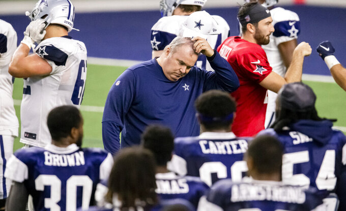 Dallas Cowboys head coach Mike McCarthy scratches his head during an NFL football training camp practice at The Star, Friday, Aug. 28, 2020, in Frisco, Texas. (AP Photo/Brandon Wade)