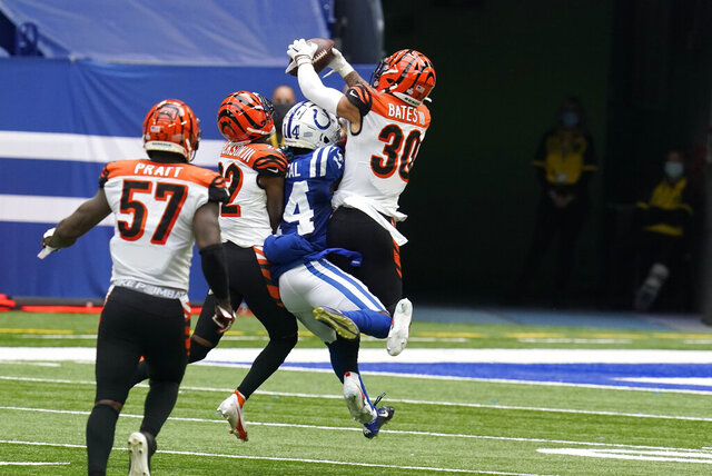 Cincinnati Bengals' Jessie Bates (30) intercepts a pass intended for Indianapolis Colts' Zach Pascal (14) during the second half of an NFL football game, Sunday, Oct. 18, 2020, in Indianapolis. (AP Photo/Michael Conroy)