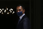 Italian Foreign Luigi Di Maio wearing a mask arrives for his meeting with his Greek counterpart at the Foreign Ministry in Athens, on Tuesday, June 9, 2020. (Costas Baltas /Pool via AP)